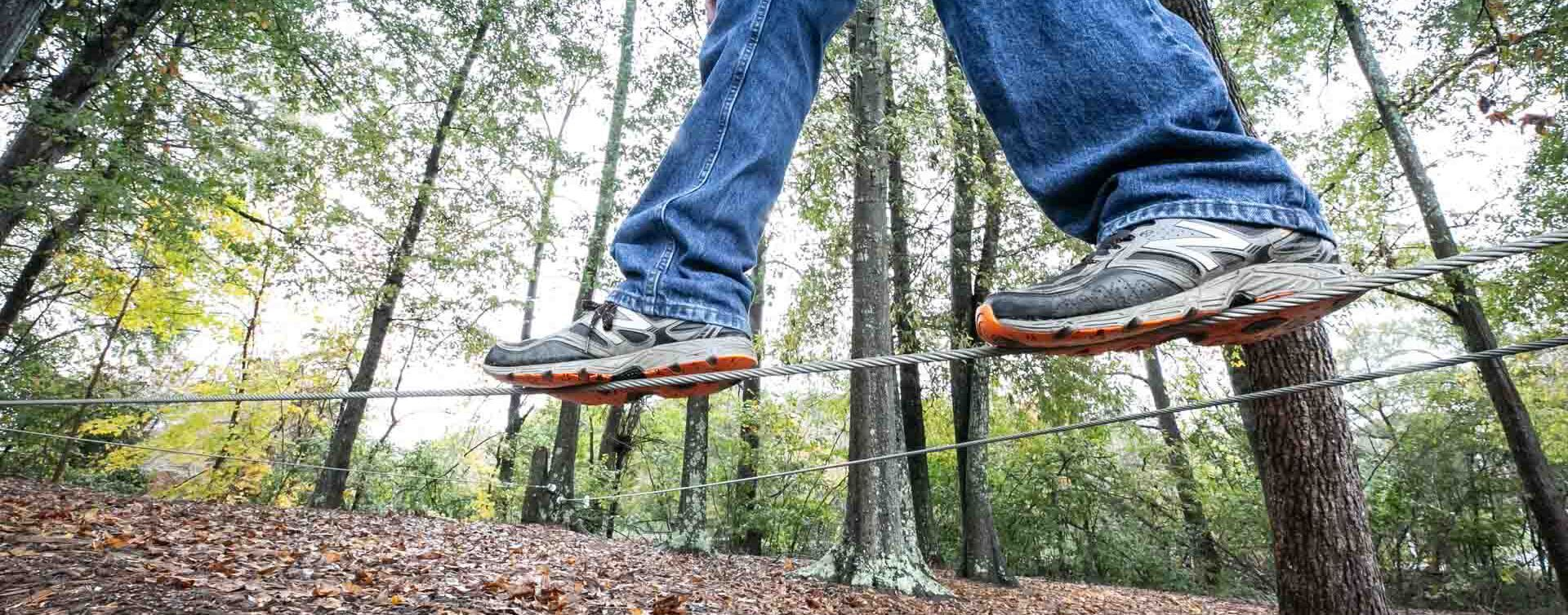 Pair of legs walking on a rope at the YMCA outdoor activities