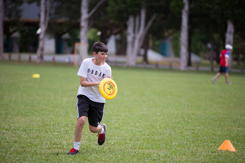 A boy playing frisbee at the YMCA of Greater Charlotte