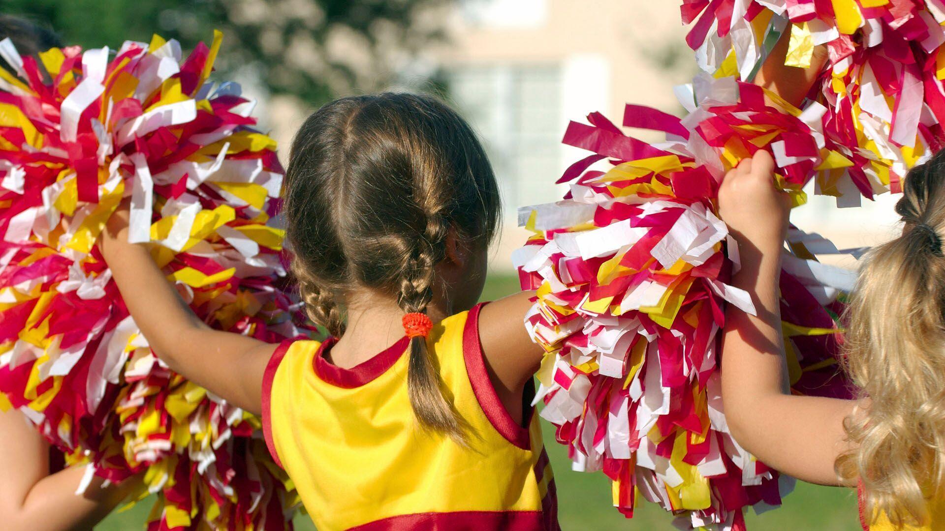 Children performing as cheerleaders