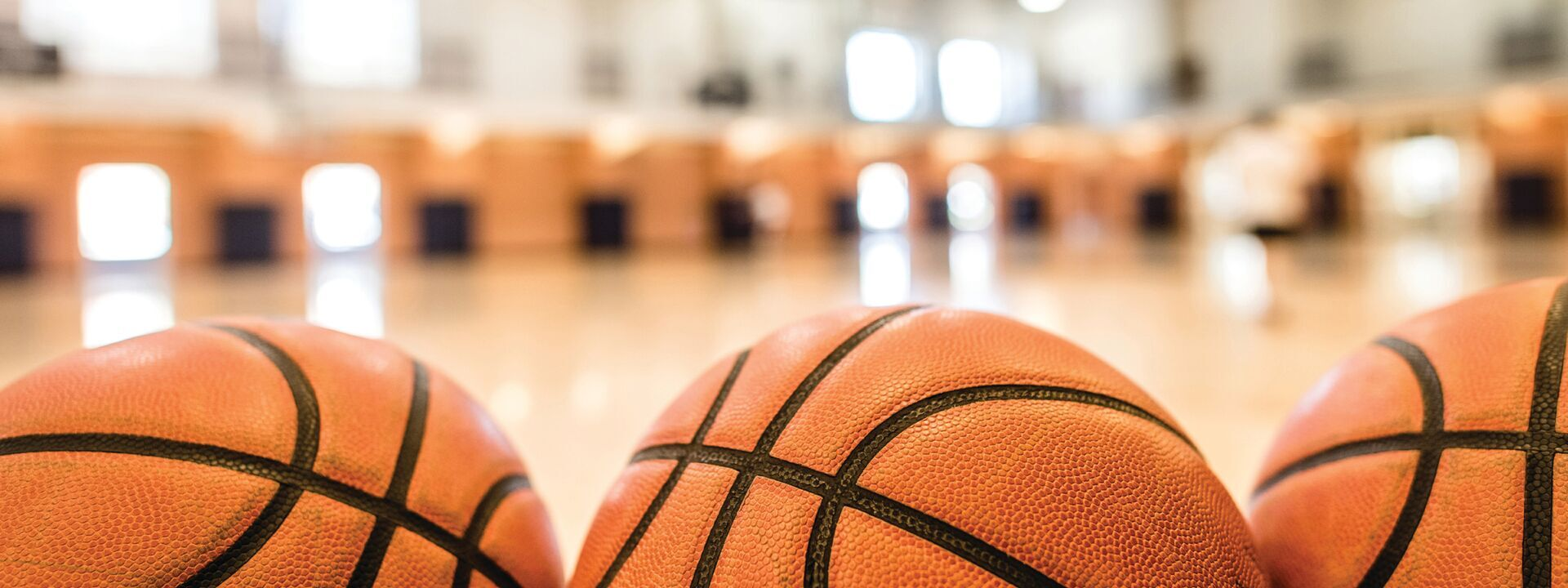 Three basketballs on the floor