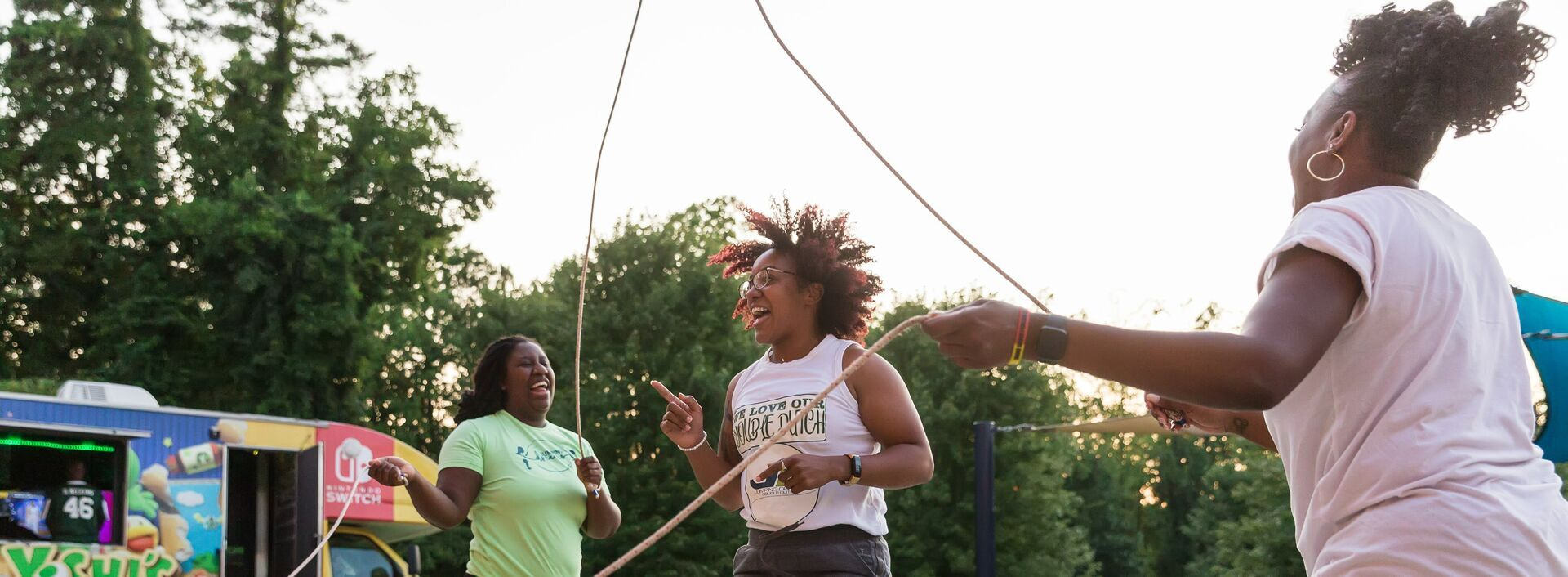 Three teens skipping and jumping at YMCA Greater Charlotte teens level up program