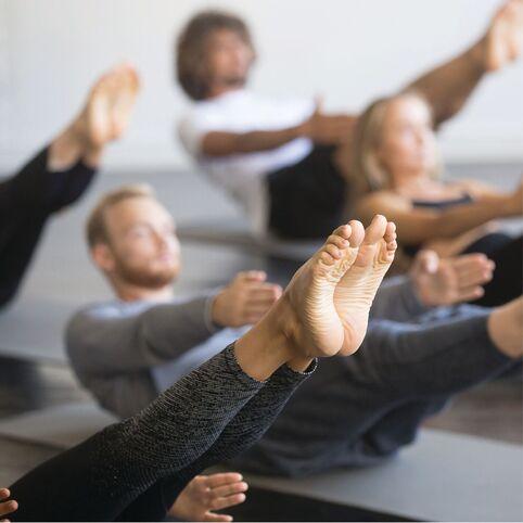 Men and women in Pilates core class - a three core-centric class