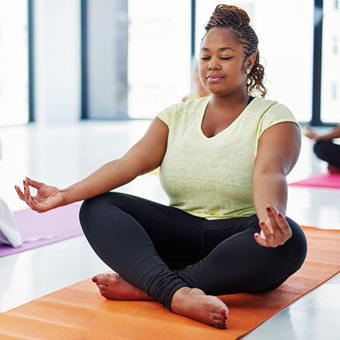 A woman meditating in YMCA of Greater Charlotte