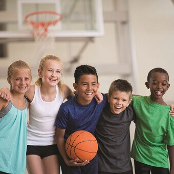 Children having fun at YMCA Greater Charlotte basketball summer day camp