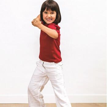 A girl practicing martial arts at YMCA martial arts summer day camp