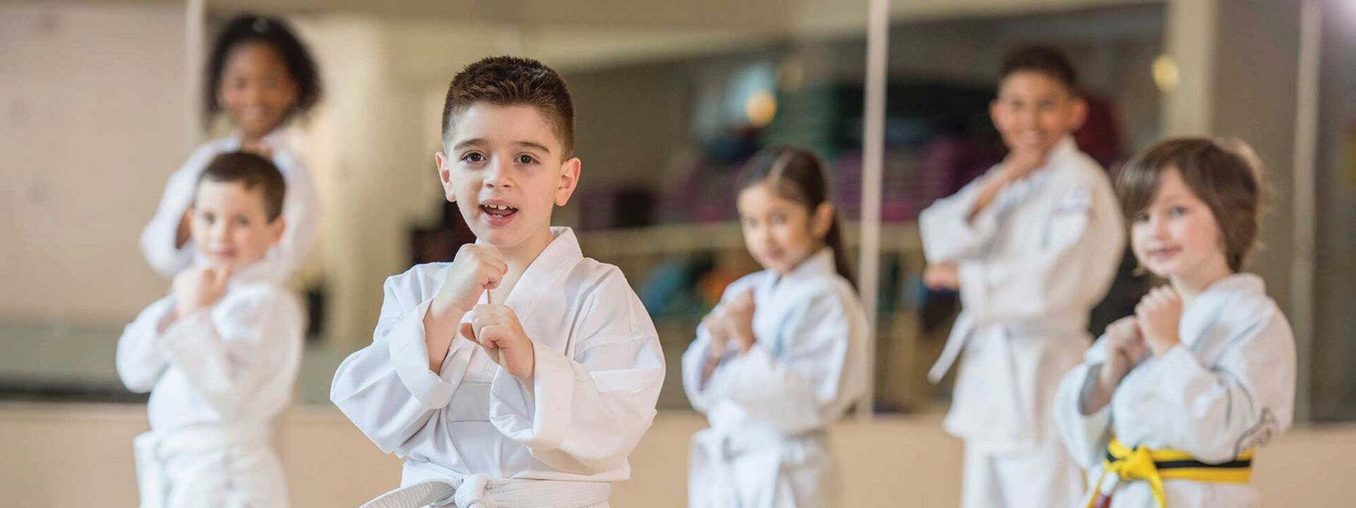 A group of children practicing martial arts at YMCA of Greater Charlotte