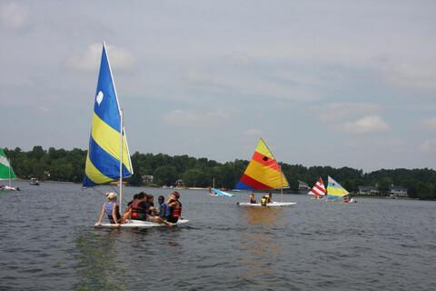 YMCA members enjoy sailing in yachts