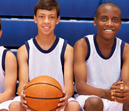 Boys posing with basketball at the YMCA of Greater Charlotte