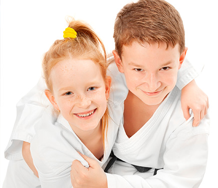 A boy and a girl wearing martial arts costume at the YMCA Greater Charlotte