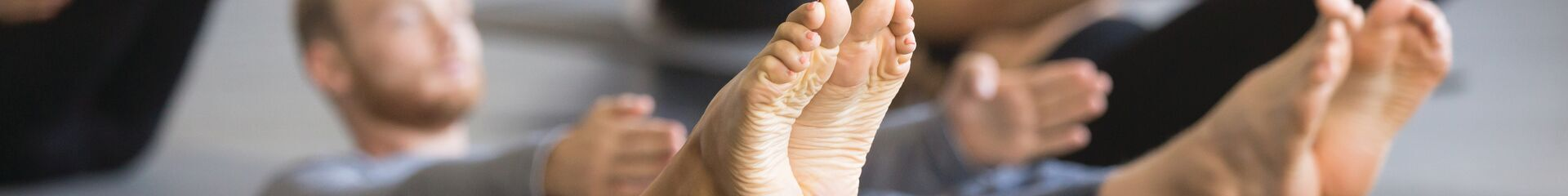 Closeup of people's feet while performing yoga