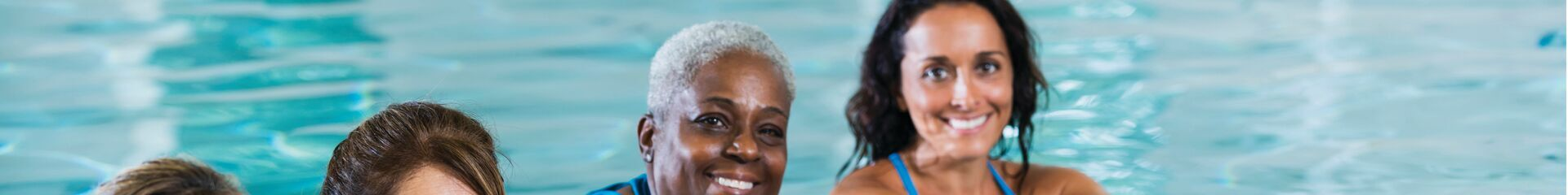 Picture of three women in the swimming pool at the YMCA water fitness classes