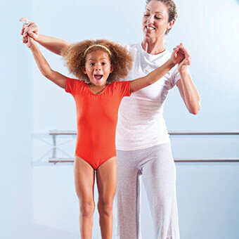 A mother and daughter in a gymnastics program at the YMCA of Greater Charlotte
