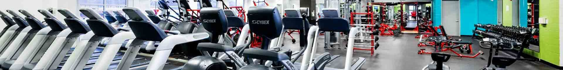 Treadmills and dumbbells in a gym